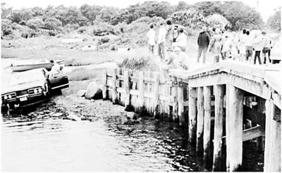 Kennedy's car is pulled from the water after it ran off a bridge on Chappaquiddick Island. Kopechne had been found near a backseat wheel well, an apparent victim of suffocation.