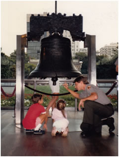 Park Ranger Bill Kashatus interprets the Liberty Bell for two young tourists in 1985.